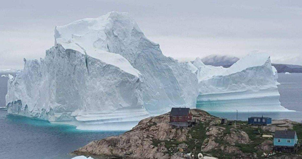 Massive iceberg breaks off from Greenland glacier