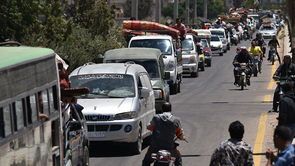 Rebels, families begin evacuating Deraa city as part of Syria ceasefire deal