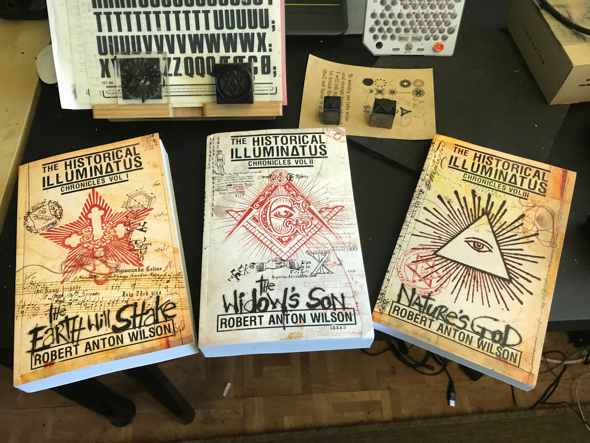 When an idea manifests itself into your reality, The Historical Chronicles of the Illuminatus Books V1-3, arrive home in the studio, sitting beside some of the rubber-stamps that i used for the covers. https://t.co/w0iomXXaIu