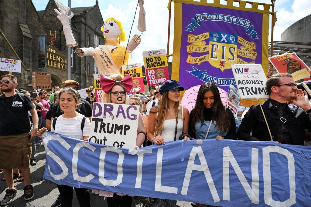 An activist has been arrested after paragliding too close to Donald Trump in Scotland