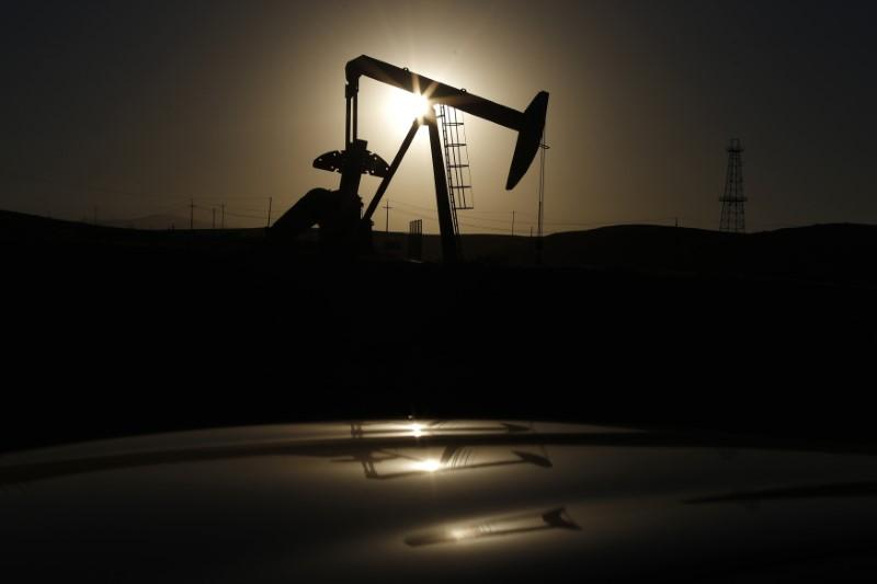 Oil prices fall on record U.S. output, stock build