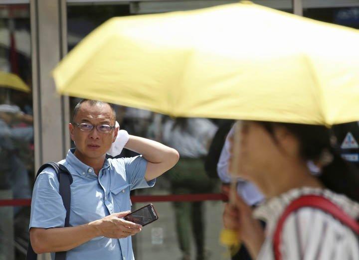 @BroadcastImagem: Temperaturas no Japão vão a 41,1°C e batem recorde. Calor já matou mais de 20 pessoas. Koji Sasahara/AP