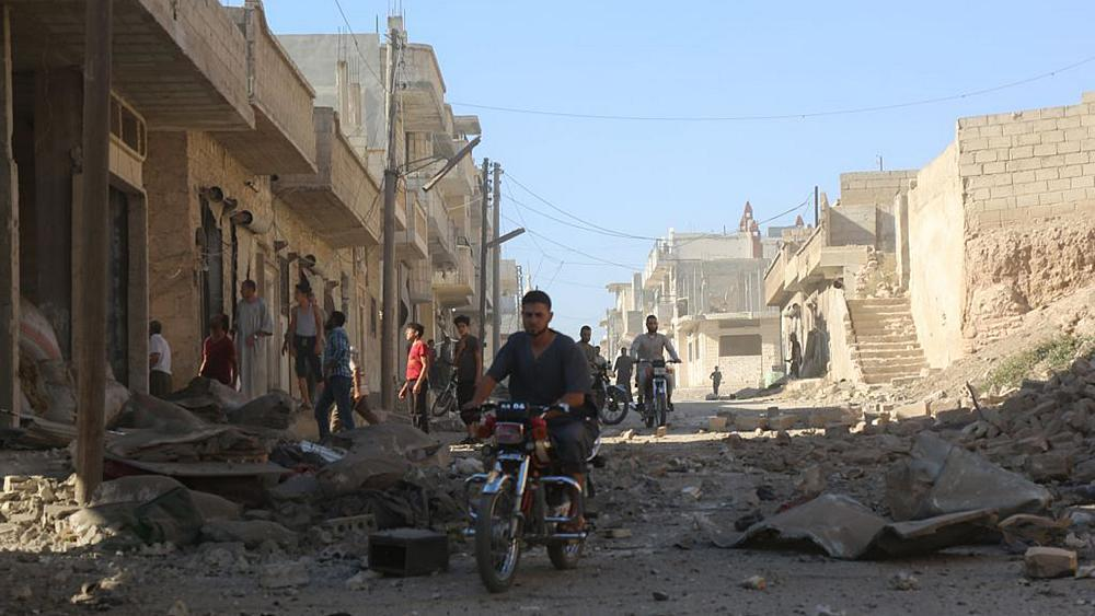Residents of Syria's last rebel enclave turn to God ahead of feared regime onslaught