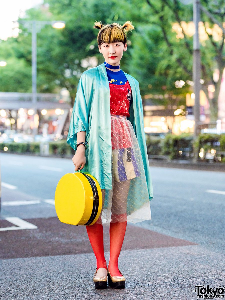 c0d54e88112 19-year-old student rikako on the street in harajuku wearing a vintage  sourced style with a satin jacket over sequin top