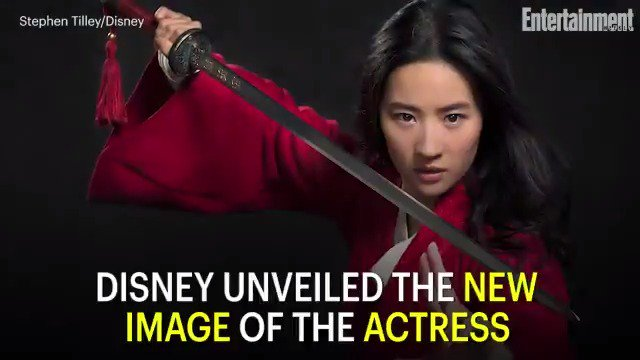 Let's get down to business! The first photo of Disney's live-action Mulan is here: