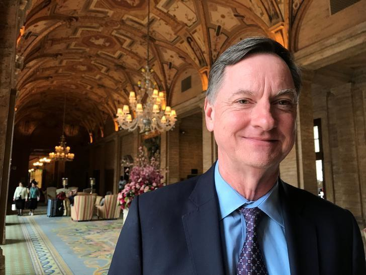 Fed policy to turn mildly restrictive in 2019, Evans says