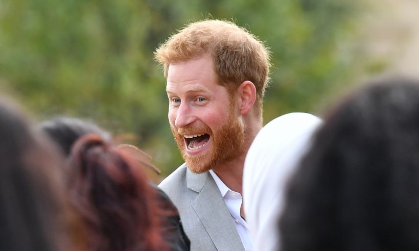 See the amusing moment Prince Harry got caught sneaking food from Meghan's cookbook launch: