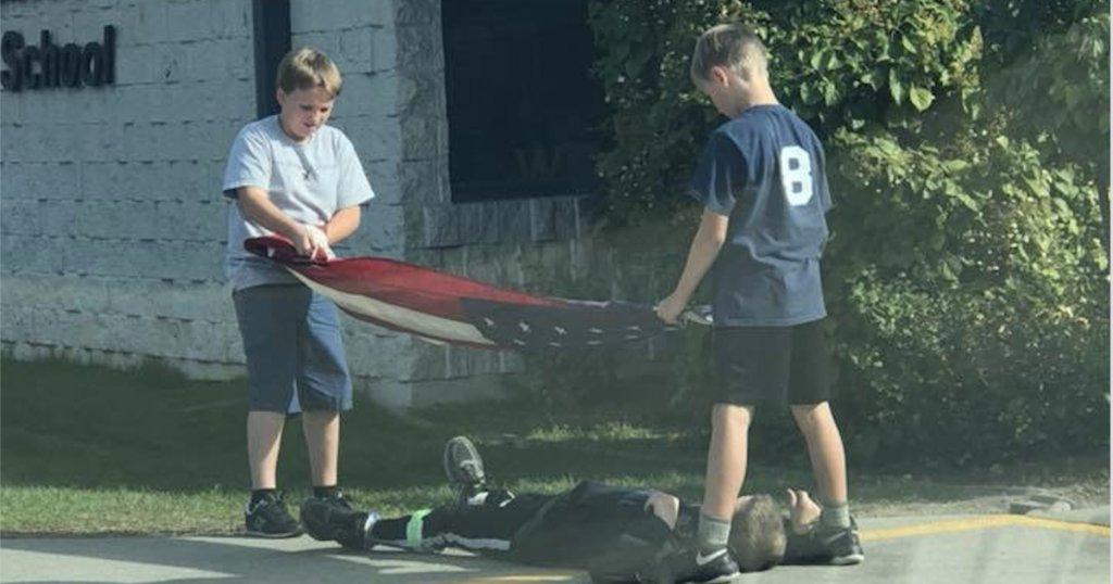 Photo of Idaho boys folding American flag goes viral