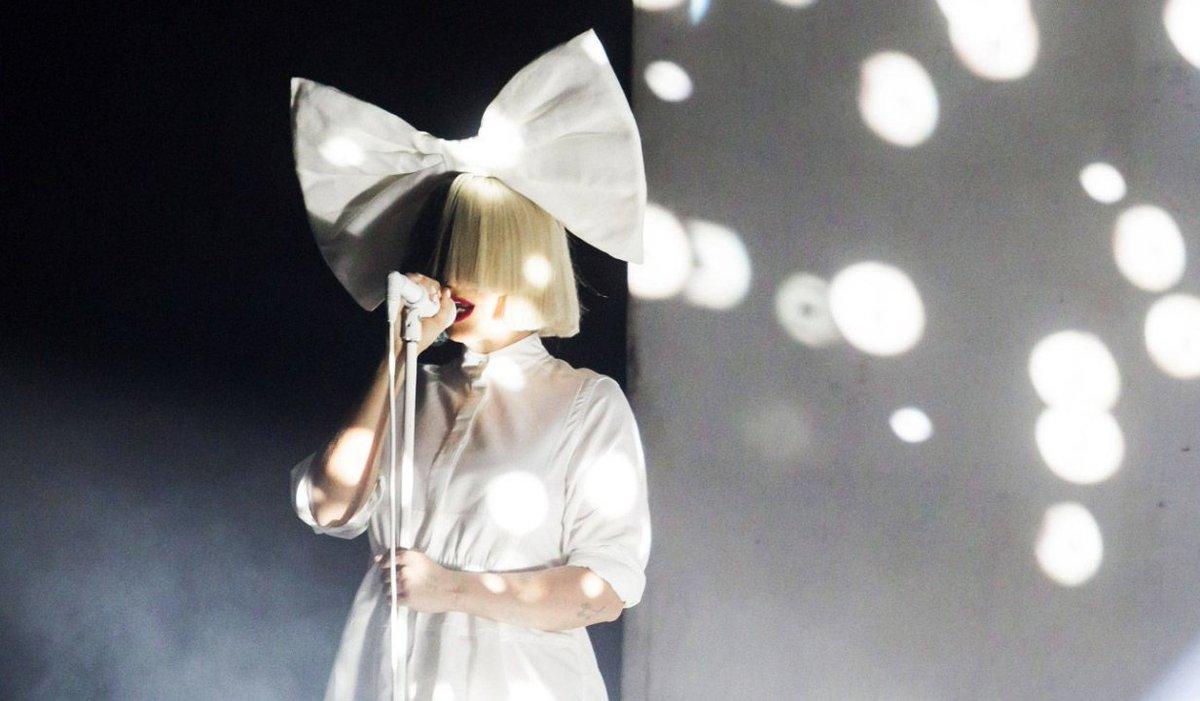 "RT @RollingStone: Hear Sia's inspiring new anthem titled ""I'm Still Here"" https://t.co/kNjGjmUpd2 https://t.co/dxT3IEAaMK"