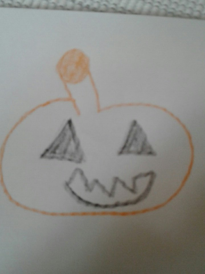 Drawing pumpkins with mini today yup I suck at drawing lol my stem looks like a ..... well you know.
