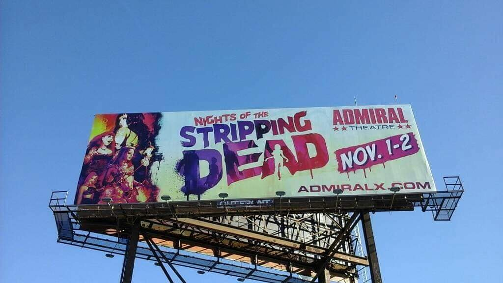 On a billboard, holy crap! Gonna get spooky at night of the stripping dead at the world famous