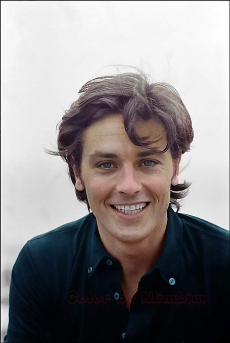 Happy (a day late!) birthday. A smiling Alain Delon is here for you.