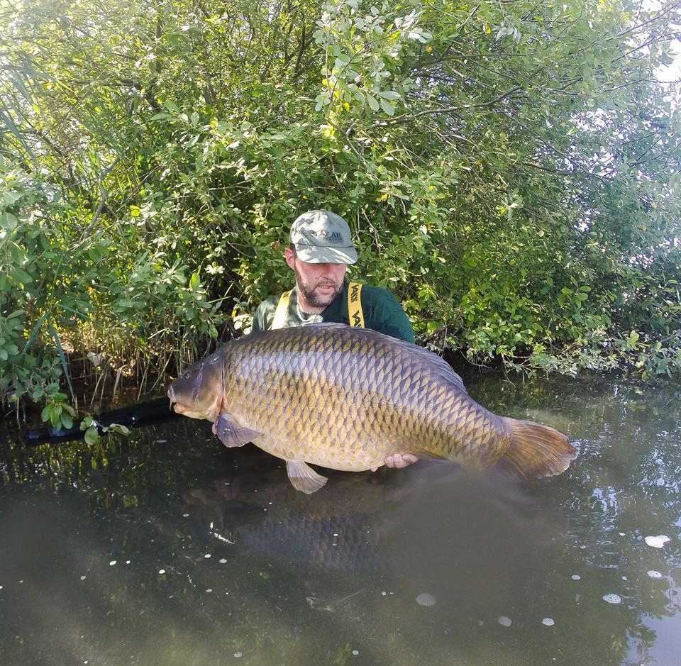 Thomas cradles a <b>Chunk</b> of a 58lb common caught on a recent day trip. #carpfishing #vass #vass