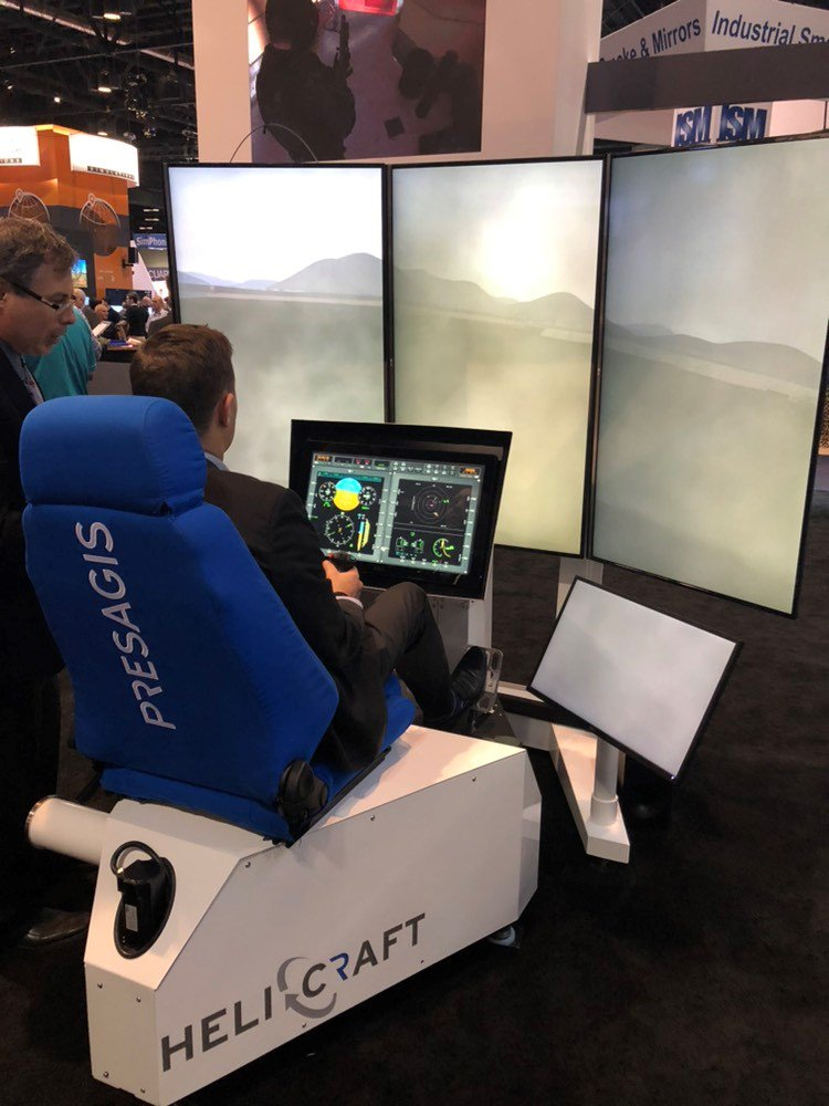 test Twitter Media - Our colleague @NicoBohly is getting a try on Helicraft from @presagis, fully motion by #DBOX. Come and try this amazing trainer at #IITSEC2018 on booth #2427! https://t.co/LXdVbKKjkt