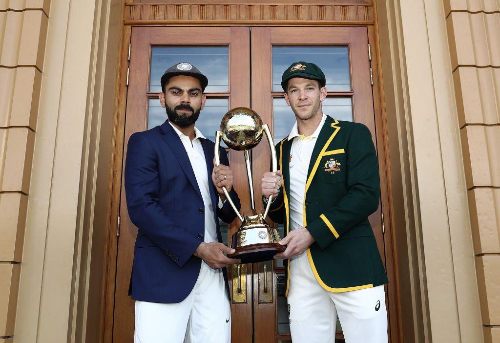 The two captains with the Border-Gavaskar Trophy at the Adelaide Oval ?????? #TeamIndia #AUSvIND https://t.co/k0av3MzcnJ