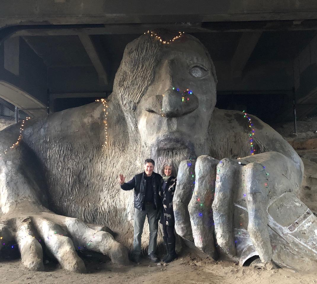 "test Twitter Media - ""We were in the big city over Xmas & Mr. Troll was looking festive!""  writes architect Steve Badanes '65, creator of Seattle's famous Fremont Troll. Pictured with his wife, artist Linda Beaumont. More on Badanes and his design/build architectural practice: https://t.co/Z8bZbjZr6O https://t.co/SShWoeXSPi"