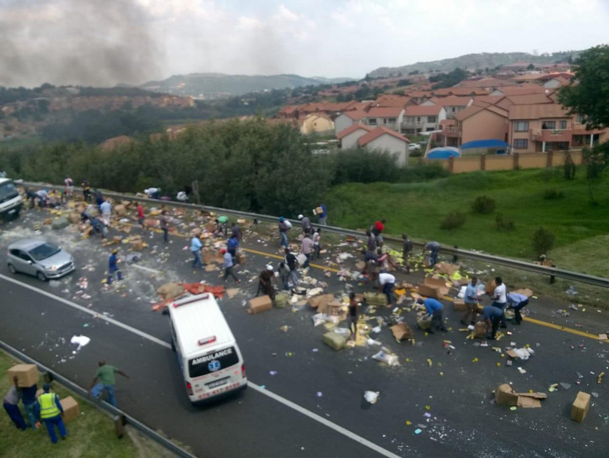 RT @Abramjee: N12 near Southgate JHB. Truck lost its load. Looting... https://t.co/yX8q0aHTeh