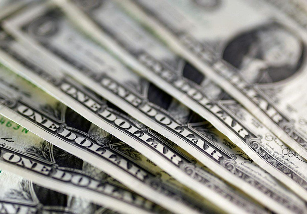 Dollar inches up after Fed minutes, trade issues back in view