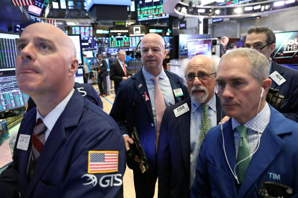 Wall St. breaks run of gains as economic data disappoints