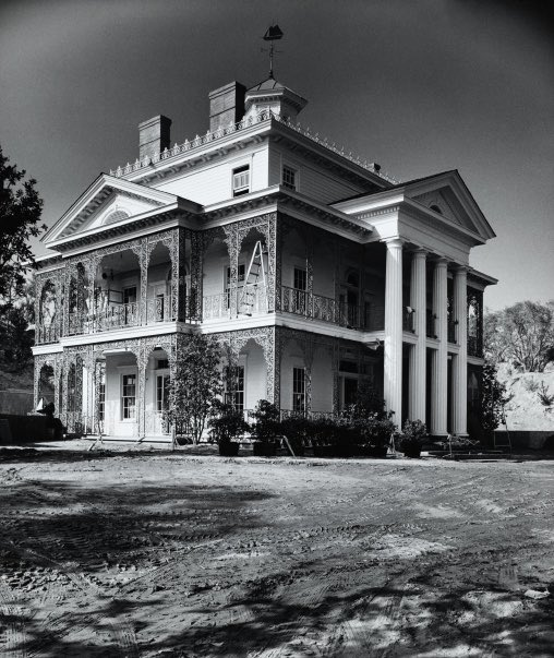 """My favorite publicity shot of the """"soon to open"""" Haunted Mansion, circa late 1962. Interesting that they took the time to vignette the shot but not to remove the ladder (which I would have added a black cat walking under). https://t.co/BSaquxJrPd"""