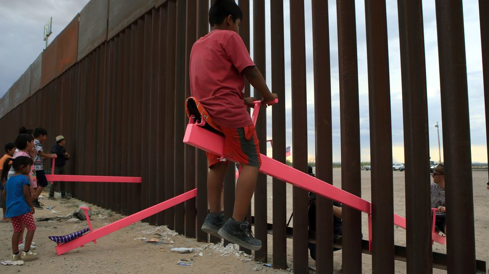 Seesaws at the border let children in Mexico and the U.S. play together despite barriers