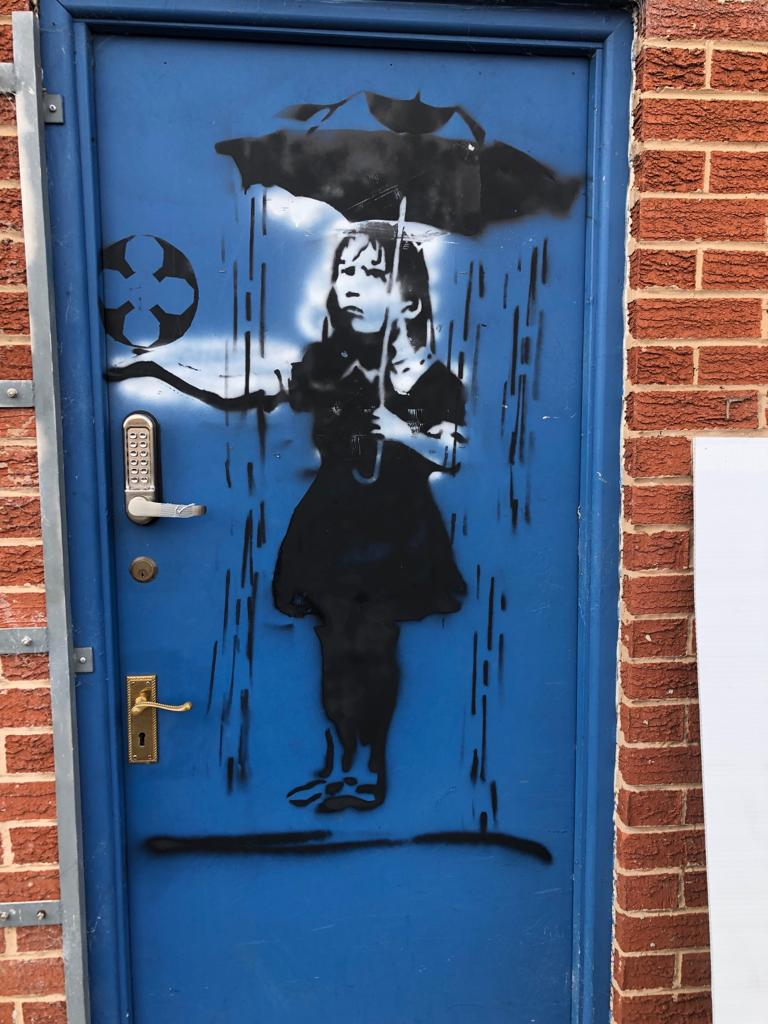 test Twitter Media - Could a #Banksy mural be the answer to #BuryFC's financial prayers?🤔  This artwork appeared on one of the stand's doors this morning... and has now been whipped off and put in storage just in case it's a genuine Banksy!  Listen on @BBCSounds: 📻https://t.co/KYWNtyKRVS https://t.co/aYhTzQKIFp