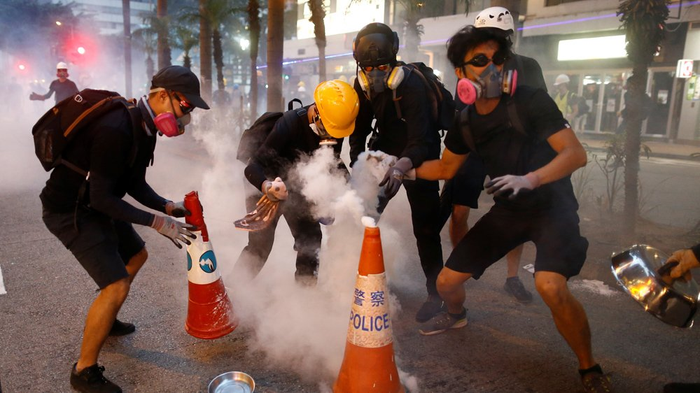 China ups rhetoric, warns of signs of 'terrorism' in HK protests