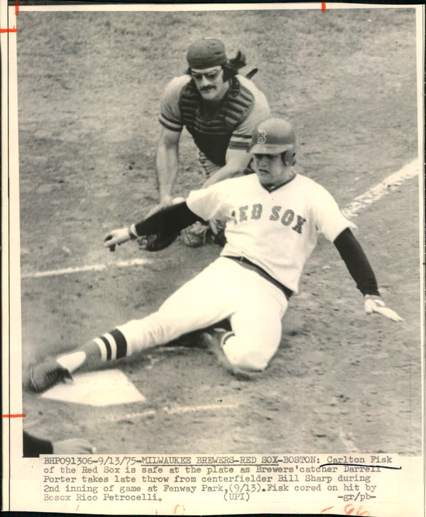 Carlton Fisk slides past Darrell Porter https://t.co/5GYxdVVqVj