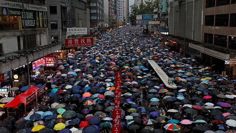 In defiance of a police ban hundreds of thousands march in latest Hong Kong protest