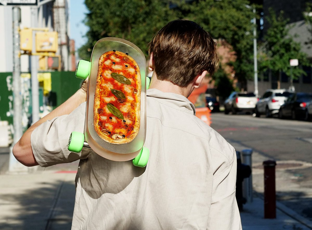 This pizza chain is giving away a custom skateboard with a real pie inside