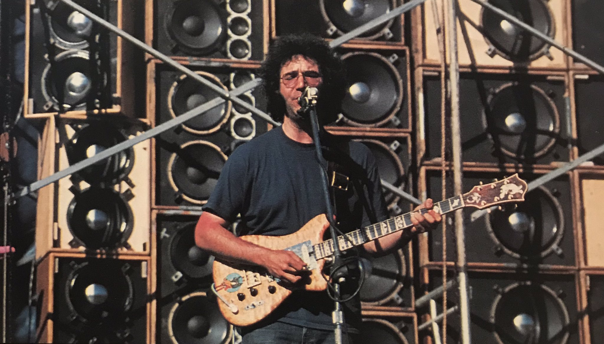 "A clean shaven #jerrygarcia backed by the ""Wall of Sound"" at the Oakland Coliseum, June 8, 1974. #gratefuldead https://t.co/P5z6vqtxC8"