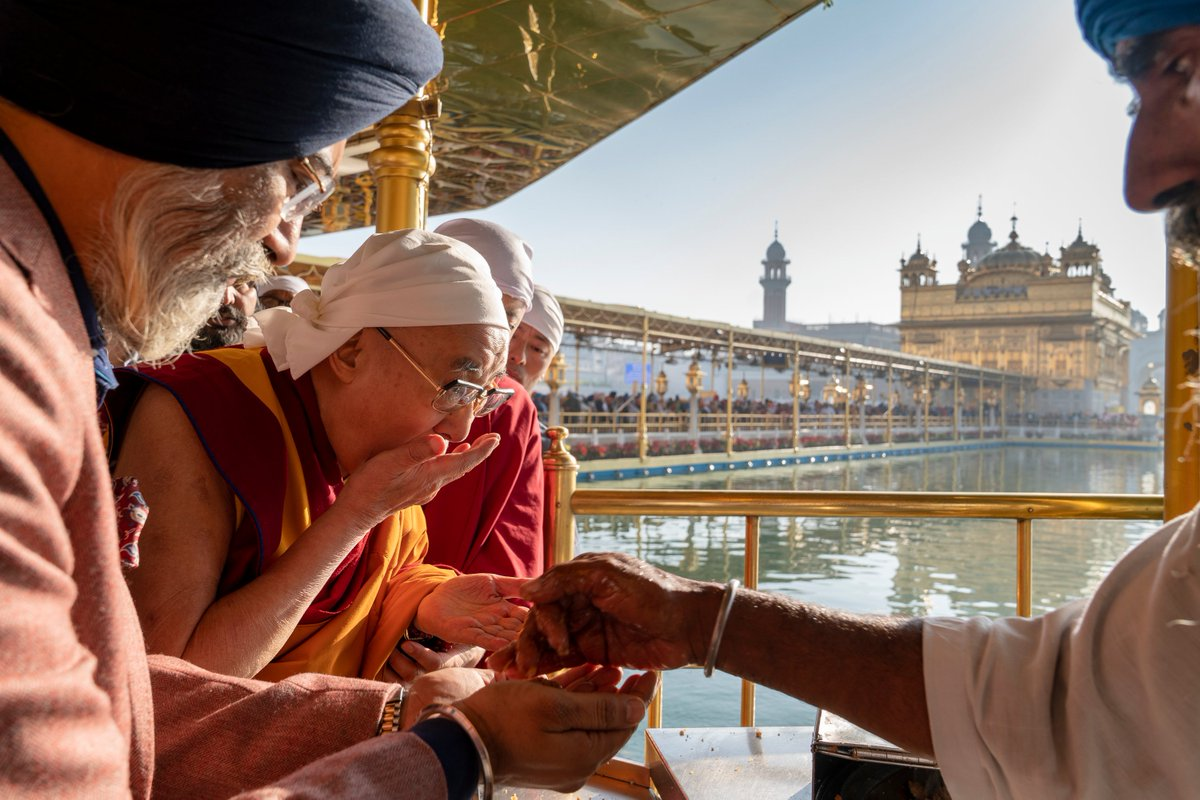 HHDL eating prasad—blessed food—that is offered to pilgrims as they leave the Golden Temple at the centre of the Harmandir Sahib, the Sikhs' holiest temple, in Amritsar, Punjab on November 9, 2019. Photo by Tenzin Choejor