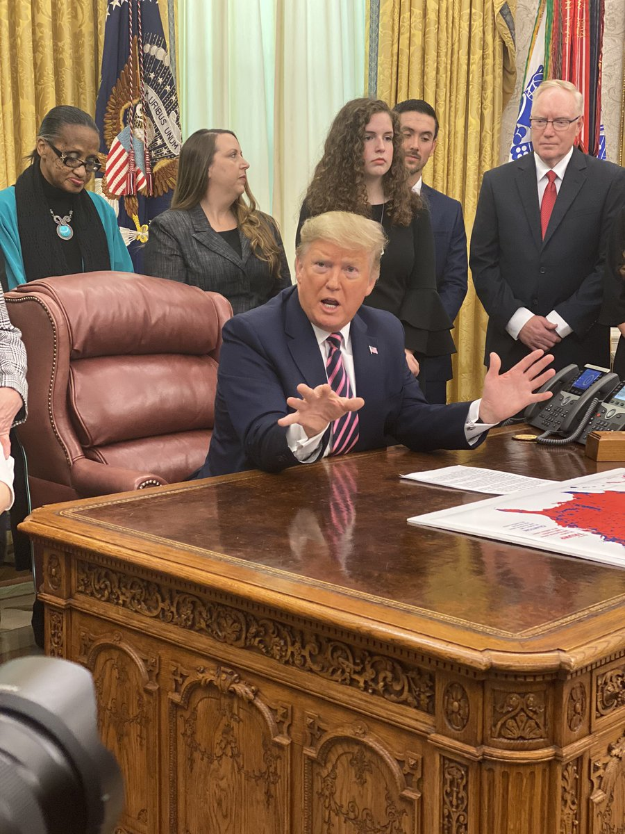 Spotted on the resolute desk in the Oval Office during the President's event on school prayer: a map of 2016 election results by county