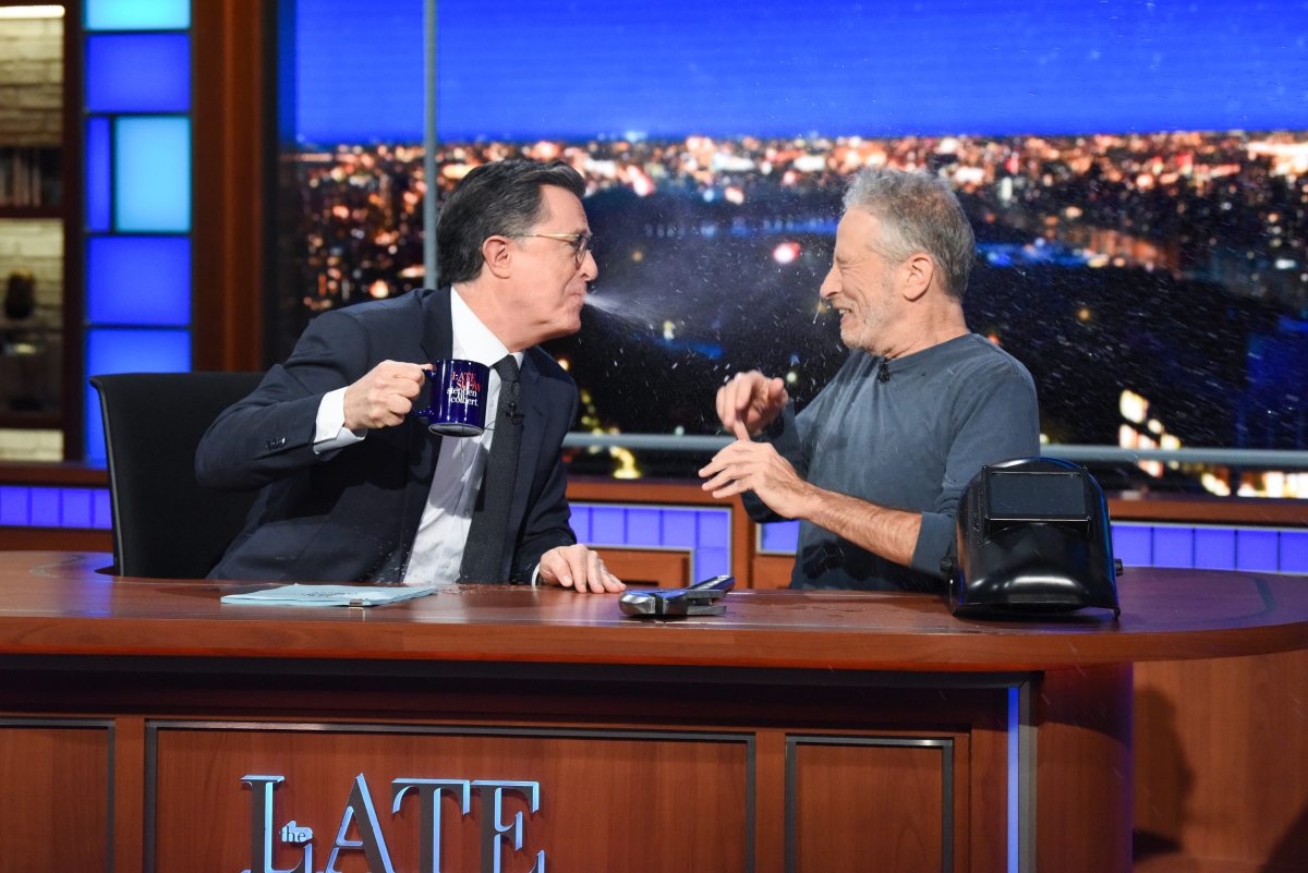 Jon Stewart climbs out from under the desk with a surprise. #LSSC