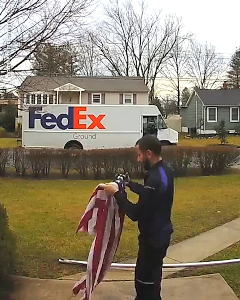 This FedEx driver stopped to pick up and fold an American flag.