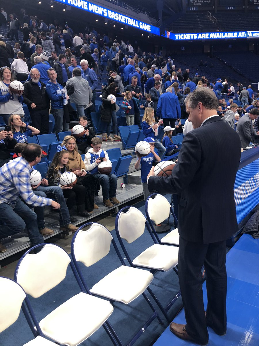"""""""If you have a ball and it didn't get signed, just come down here.""""  The radio show is over, but Coach Cal is sticking around to make sure everyone who stayed gets their autograph."""