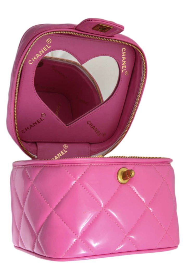 imagine having this pink vintage chanel bag with a heart shaped mirror on the inside