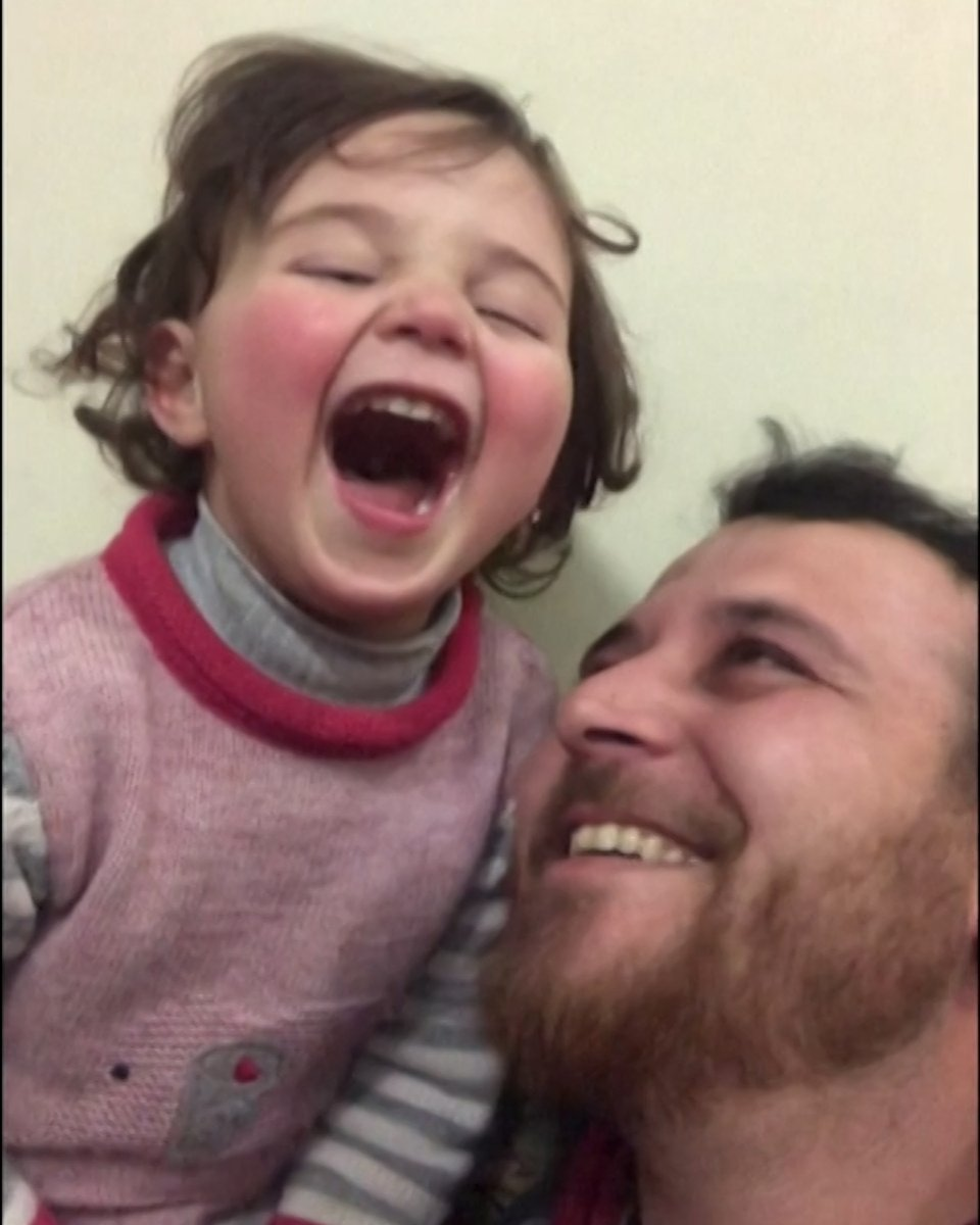 This father is teaching his daughter to laugh at bombs – in order to help her cope. This is life in a conflict zone: