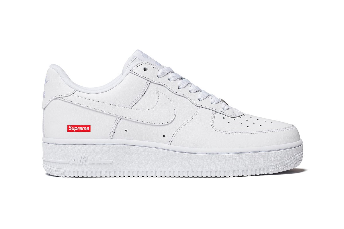 """Here's an official look at the #Supreme and #Nike Air Force 1 Low. Available in """"White"""" and """"Black,"""" the collaborative shoe is crafted of premium leather and is marked with small red Supreme Box Logos on the side heel. Stay tuned for more release info. Photo: Supreme"""
