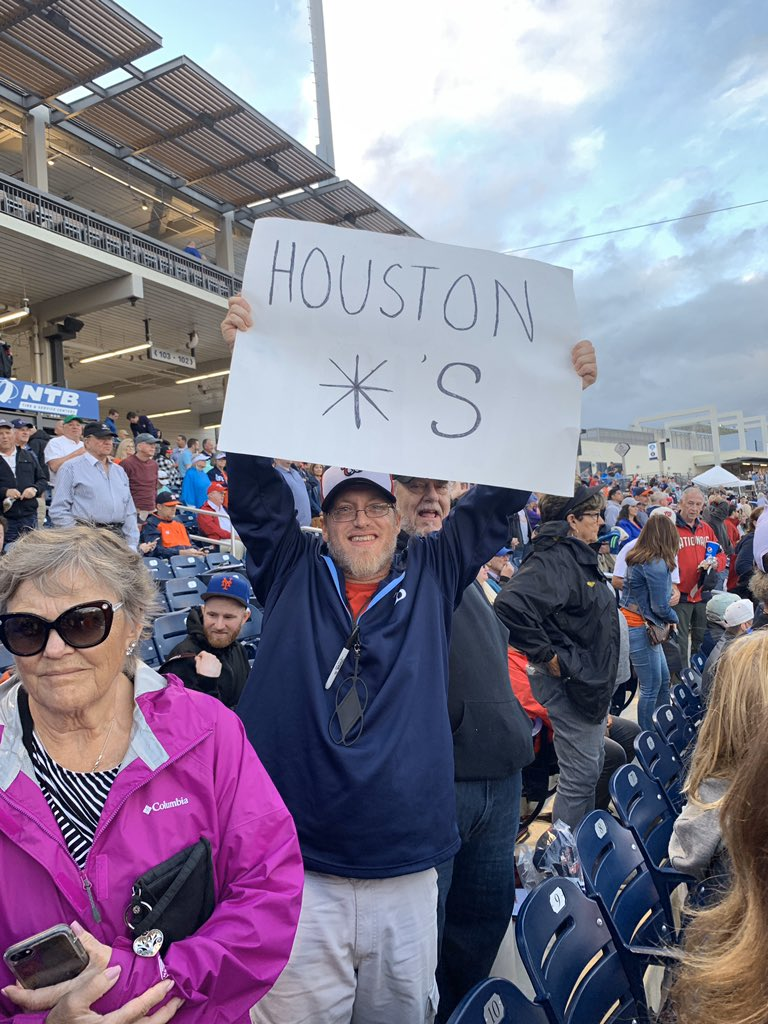 This fan was holding this sign as the Astros players walked off the field after the National anthem. A few seconds later stadium security confiscated it.