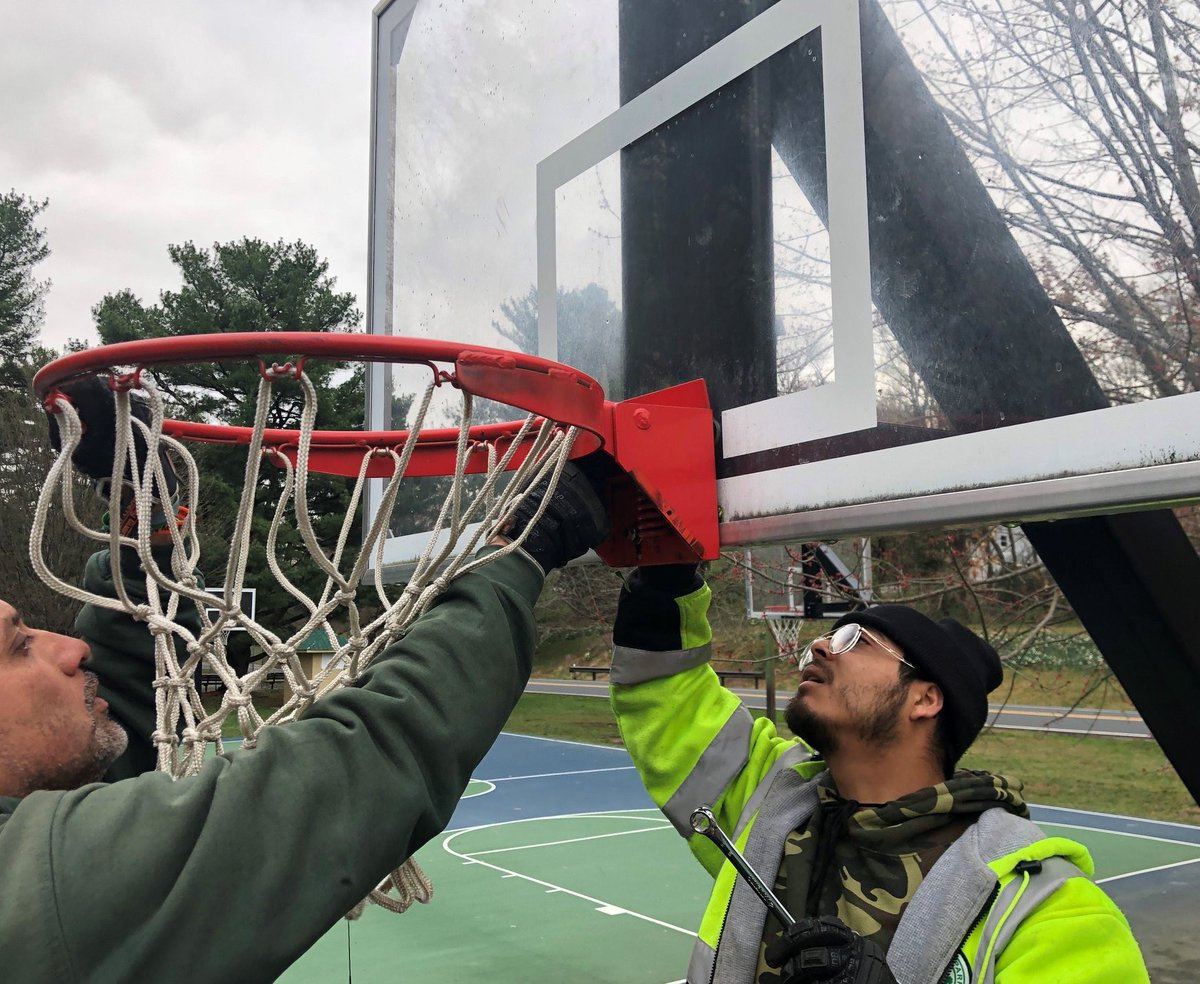 This picture shows, from Casey Anderson (chair of the Montgomery County Planning Board), shows Montgomery Parks maintenance staff removing the basketball hoops from the courts off Sligo Creek Parkway near Dennis Avenue.   Too many ppl ignoring instructions not to gather.