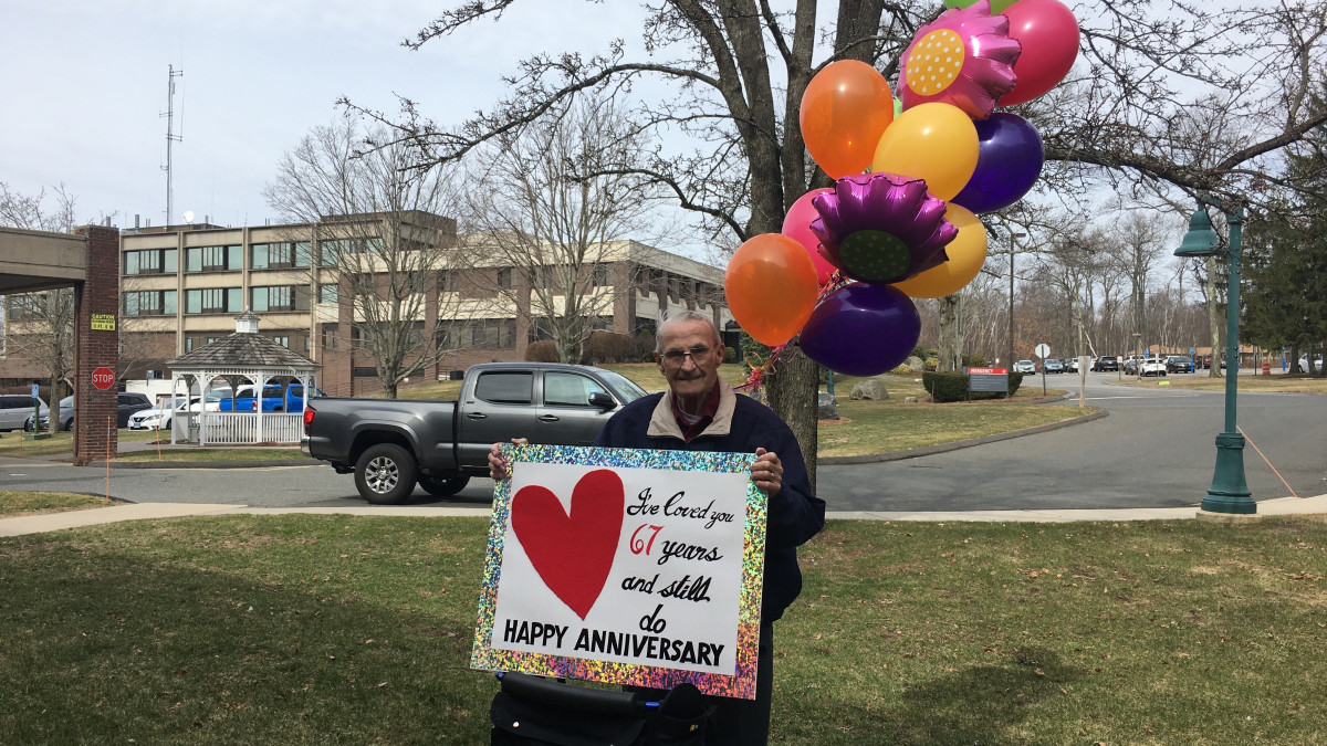 "Due to coronavirus precaution, Bob Shellard isn't allowed to visit his wife in her Connecticut nursing home. So he stood outside her window and held up a sign that said ""I've loved you 67 years and still do. Happy Anniversary."""