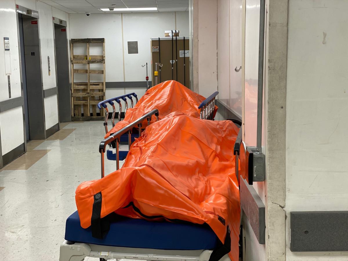 Disturbing photos show body bags filling the hallways of a Brooklyn hospital