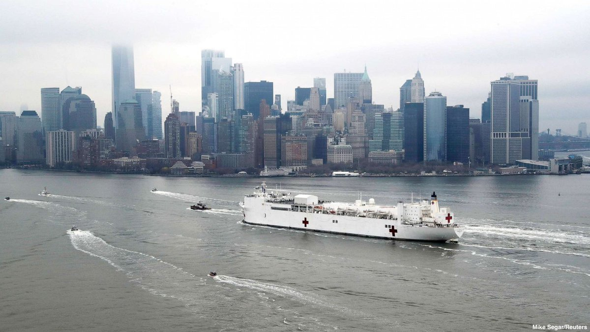 The USNS Comfort enters New York Harbor during the coronavirus outbreak.  The ship is equipped with 1,000 patient beds, 12 operating rooms, eight intensive care unit beds, and up to 1,200 Navy medical and communications personnel.
