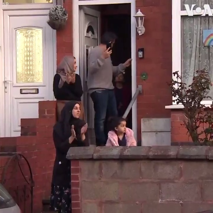 CORONAVIRUS:  People across the U.K. joined in standing outside their homes and applauding those working to battle the COVID-19 pandemic, Thursday. The U.K has so far reported 33,718 COVID-19 cases, and 2,921 deaths.   (AP)