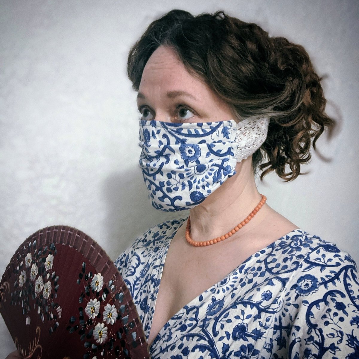 This season, the elegant young lady is wearing a figured cotton gown and matching mask trimmed with white lace. Coral beads complete the ensemble.  #QuarantineRedCarpet  (I used the @nytimes pattern, modified because this was the elastic I had.)