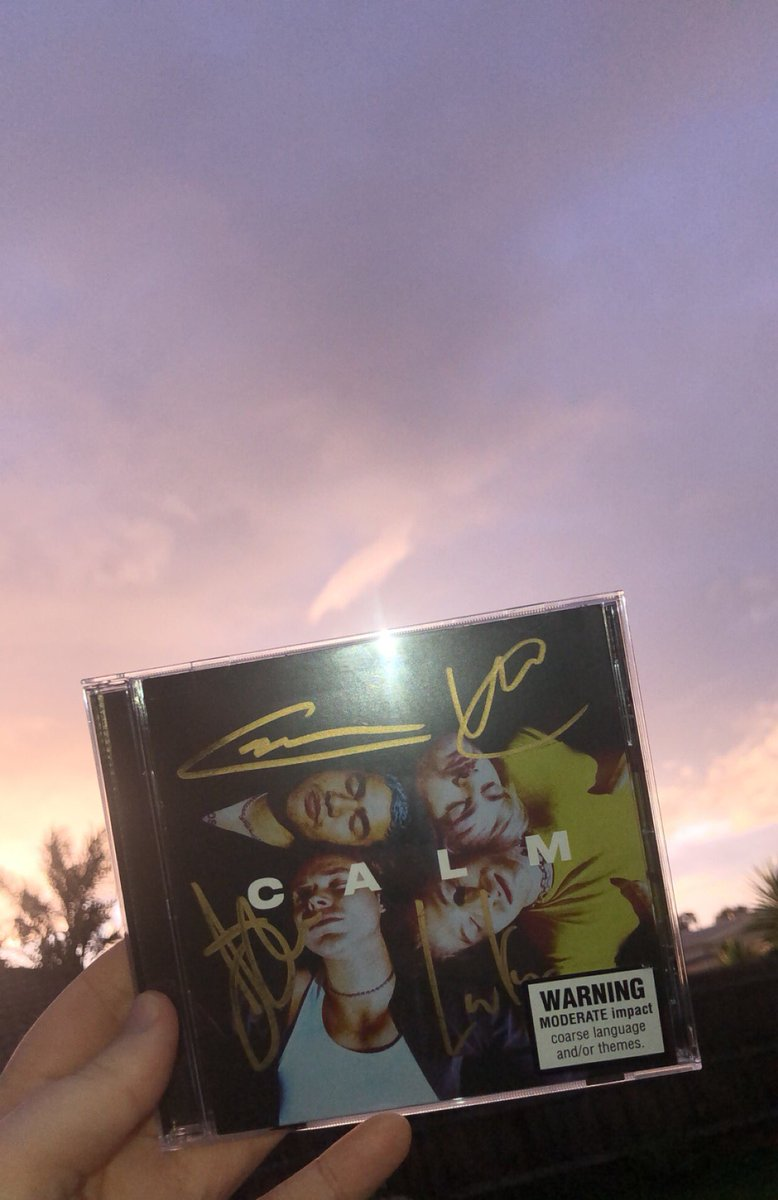 don't mind me, im just holding the number one album in australia 🤍  @5SOS #5SOS #CALM