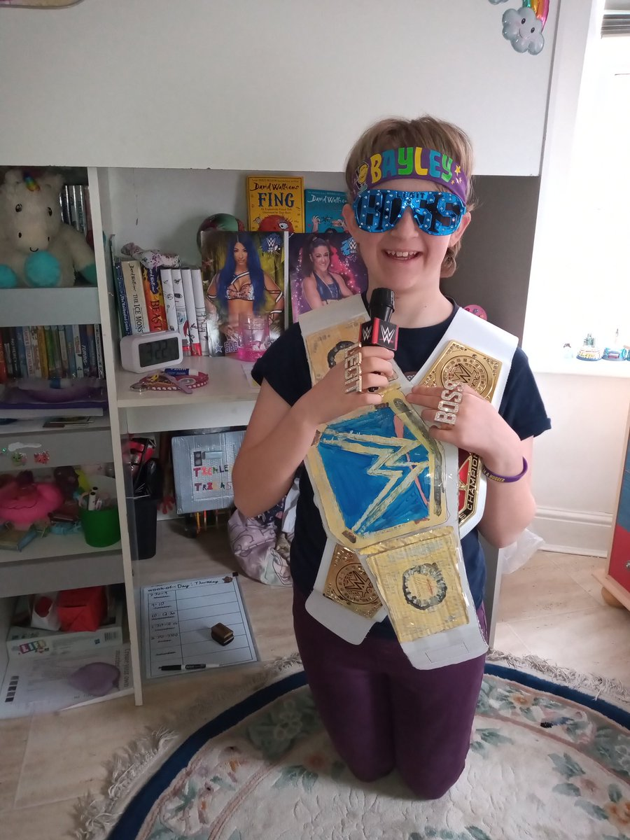 Here's my step-daughter Sephira, prepping for #WrestleMania , complete with her homemade #SmackDown belt. All ready to cheer on her #rolemodels @itsBayleyWWE and @SashaBanksWWE . All the best from the UK🤩🤩🤩