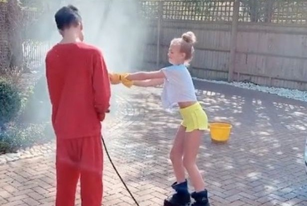 Peter Andre's kids erupt into massive water fight as they wash his fleet of cars