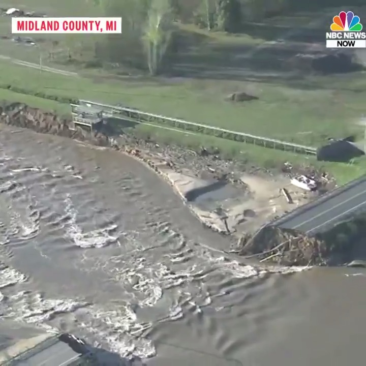"""Aerial footage shows scale of flooding in central Michigan.  Two """"catastrophic"""" dam failures forced 10,000 to evacuate, with the National Weather Service warning of a """"life-threatening situation."""""""